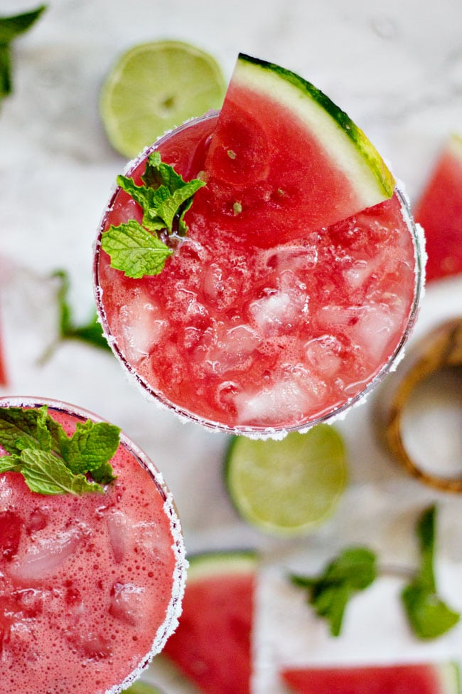 The best watermelon agua fresca recipe ever. All you need is a watermelon, water and a splash of alcohol and you've got yourself a simple, big batch cocktail perfect for serving at your summer wedding.