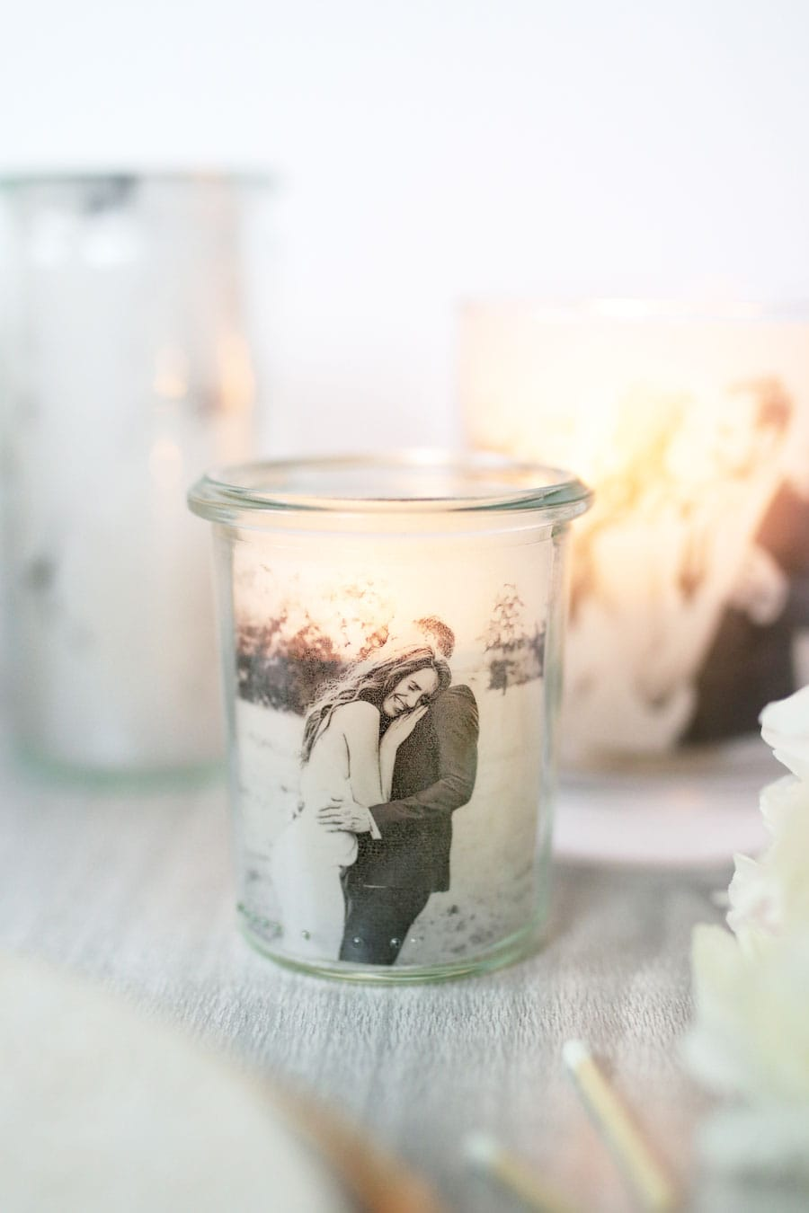 These DIY candle holders incorporate photos of you and your love and are sure to give your guests something to talk about at your wedding reception.